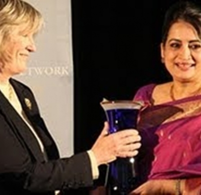 Selima Ahamd recieving Jean J. kirkpatrick Award